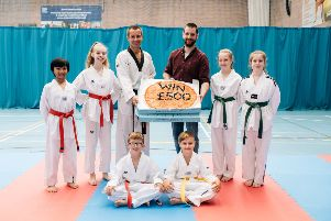 Peter Stewart, coach and Philip Pettitt, general manager, Little Wing Little Stars, pictured with members of the Taekwondo club, one of last year's winning clubs