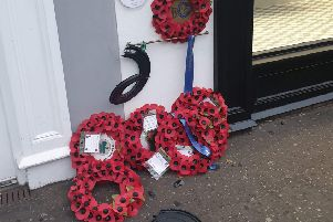 Wreaths laid in memory of six soldiers killed in a bomb attack in Lisburn have been vandalised