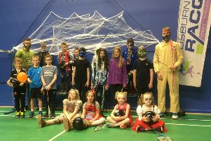 Hallowe'en down at Alpha Badminton Club with coaches Ross Treacy (back row left) and Matthew Prentice (back row right)