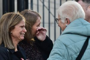 Family of Robert Flowerday console each other outside court on Friday