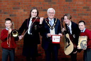 The Mayor, Councillor Alan Givan is joined by local school pupils: Gemma and Daniel from Pond Park Primary School and Julie and Owen from Wallace High School to promote the 'Fly Me to the Moon' concert to raise money for the Mayor's charity, Air Ambulance NI.