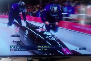 Team GB pilot and former Crawley AC decathlete Brad Hall, right, in action with Joel Fearon compete in heat one of the Two-Man Bobsleigh event held at the Sliding Centre at PyeongChang in South Korea.'Picture by Graham Carter SUS-180218-130601002