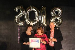 Jackie Kerr receives the CEO Award from chief executive Suzanne Millard, left