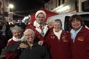 Billy with members of the Edwin James Festival Choir enjoying the Littlehampton Christmas light switch-on WAPWQYFZnQjt08luNqlw
