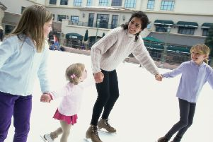 Mother ice skating with her three daughters ENGSUS00120131031090527