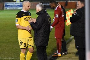 Shaun Saunders discusses tactics with Kane Louis on Saturday. Picture by Grahame Lehkyi
