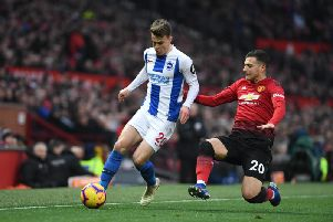 Brighton's Solly March attempts to burst past Man United's Diogo Dalot. Picture by PW Sporting Photography.