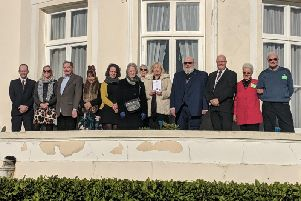 The congregation at Beach House in Worthing after three restored plaques were unveiled