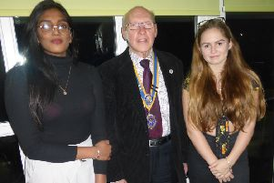 Dikaxiha Rajandran, left, and Catherine Topham with club president Bruce Green