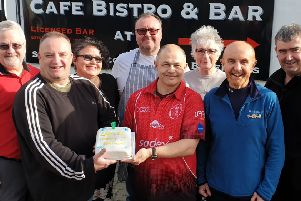 Celebrating the first birthday, vice-chairman Ian Buckland, left, and chairman Ian Neville with the cake, and Cafe 72 owner Gary Hughesdon with his wife Ruth, behind