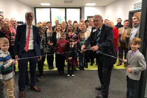 Sir Peter Bottomley cutting the ribbon at the new Strand Medical Group practice
