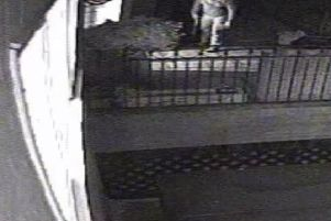 Operation Prometheus. CCTV footage of the burglar getting ready to enter a house with a sawn-off-shotgun. Supplied by Surrey Police. PPP-180130-120306001