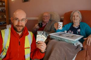 apetito delivery driver Will Gordon delivers the complimentary hot chocolates to Meals on Wheels customers Terence and Jean McEwan.
