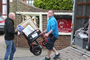 Two men removing a wheelchair and other belongings from the care home. Picture by Eddie Mitchell