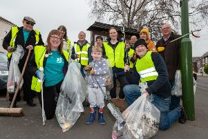 Wick, Littlehampton, West Sussex, UK. 22nd March 2019. The Wick Village Traders Association organise a spring clean event of Wick Village in Littlehampton to support The Great British Spring Clean national campaign. In Pic: Volunteers collect rubbish in Wick.