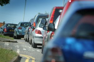 A two-car collision on the A27 is causing delays