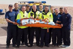 The Shoreham Coastguard volunteers with the stretcher
