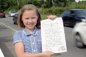 Daisy Jenkins, 10, with the colourful letter she wrote in Ford Road, Arundel
