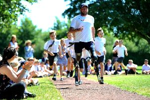 Paralympian Luke Sinnott opens the Daily Mile track at St Margaret's Primary School in Angmering. Picture: Steve Robards SR1917688