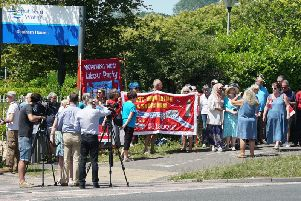 The protesters outside the headquarters in Worthing this afternoon