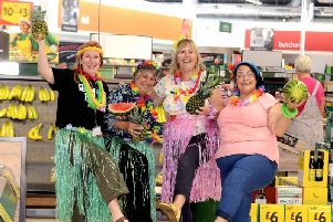 Catriona Magee, fundraising manager for CLIC Sargent in Sussex, left, with Morrisons staff. Picture: Kate Shemilt ks190449-1