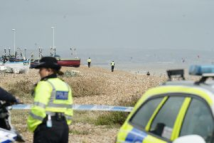 Officers comb the beach