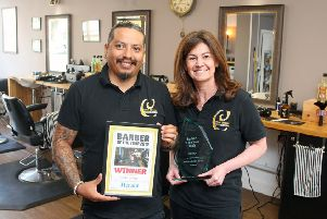 Herald and Gazette Barber of the Year winner Celine Barbers owner Celine Cantaloube and barber Jhon Alarcon. Photo by Derek Martin DM1991381a