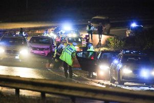A police officer was seriously injured when he was hit by a passing car on the A27