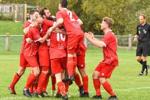 Hassocks celebrate a goal against Loxwood on Saturday. Picture by Chris Neal