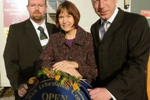 Julie Roby fro the Wick Information Centre with Barry Lane and Stuart Marshall from Morrisons in 2012, when the grant was given