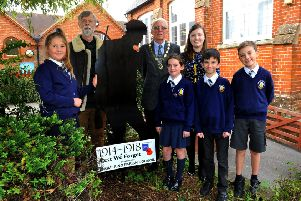 Angmering Parish Council chairman John Oldfield, right, presents the Silent Silhouette to deputy head teacher Natalie Carless, with local historian Roger Miles and children from the school. Picture: Steve Robards SR23101902