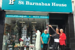 Staff and some of the volunteers at the St Barnabas House shop in High Street, Sthoreham