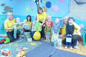 Staff and children at the Worthing Leisure Centre creche with the new toys