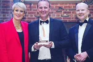 Shane Hilton is presented with his Kitchen Designer of the Year award by BBC TV presenter Steph McGovern and John Pickering, managing director at Miele GB