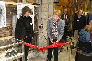 The Lord Lieutenant of West Sussex, Susan Piper cuts the ribbon accompanied by director Valerie Mills. Photo by Derek Martin Photography. SUS-191118-181355008