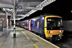 The GWR Class 166 Turbo No.166211 pulling into platform one at Worthing railway station
