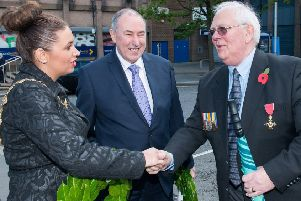 Sinn Fein's Elisha McCallion shakes hands with Glen Barr before  the annual commemoration service of the Battle of Messines at Londonderry Cenotaph in 2015. Also pictured is Sinn Fein's former Assembly speaker Mitchel McLaughlin