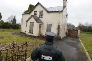 Police at the scene at a derelict property in Maghera on Friday as they launch a murder investigation into the death of Piotr Krowka.