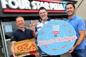 BULLSEYE: World no.5 darts player, Daryl The Superchin Gurney (centre), is joined by Four Star Pizza Directors, Ciaran Bradley and Teague Whoriskey to launch the first ever Four Star Pizza NI Darts Challenge.