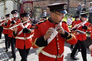 Members of the Churchill Flute Band pictured on parade in Londonderry