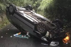 The car landed on its roof after it was flipped over.