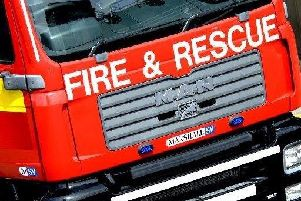 Man being treated for burns after being pulled from blaze in flat