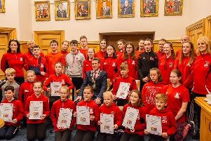 Junior members of the City of Derry Spartans and coaches Bridgeen Byrne and Martina McCafferty pictured at the launch of the new Athlete Wellbeing Programme in the Guildhall.