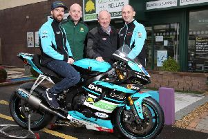Alastair Seeley pictured with EHA Racing team boss, Edward Allingham, David Shirley of J.P. Corry, Coleraine, and NW200 Event Director, Mervyn Whyte.