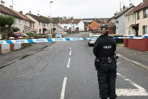 A P.S.N.I officer at the scene of one of the security alerts in Londonderry. (Photo: Pacemaker)