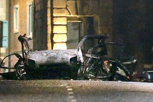 The wreckage of the car that was used in Saturday night's attack in Londonderry city centre