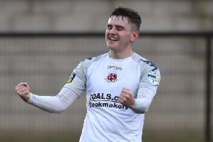 Crusaders Ronan Hale celebrates scoring his first goal for the club, at Institute.