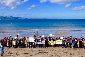 The gathering at Brown's Bay in Islandmagee on Sunday.