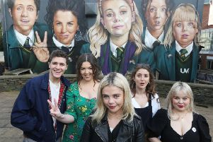 Derry Girls creator Lisa McGee, second from left, with cast members Dylan Llewellyn , Saoirse-Monica Jackson, Louisa Harland and Nicola Coughlan when they visited the 'Derry Girls' mural painted by UV Artists on the gable wall of Badger's Bar, Derry. The second series of the hit show is coming soon to Channel 4.