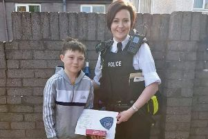 An officer representing the PSNI's Bogside, Brandywell and The Fountain Neighbourhood Team thanks Tiernan McCready for his courageous actions.
